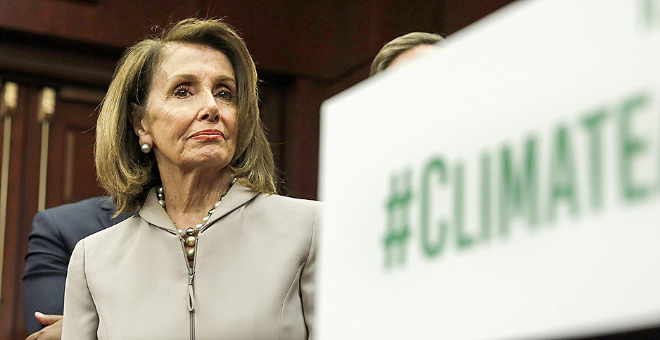 House Speaker Nancy Pelosi (D-Calif.) with #ClimateNow sign. Photo credit: Yuri Gripas/UPI/Newscom