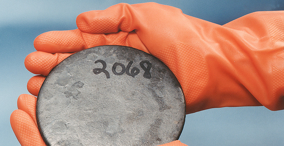 Hands holding uranium. Photo credit: Department of Energy/Wikipedia