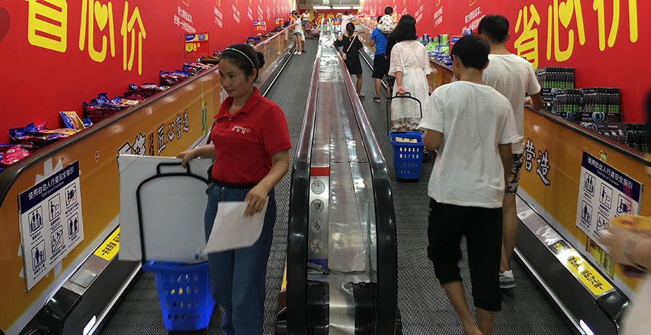 Shoppers visit a Walmart Superstore in China. Photo credit: EPN/Newscom
