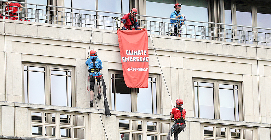 Climate protesters in front of BP headquarters. Photo credit: Aaron Chown/PA Wire(Press Association via AP Images)