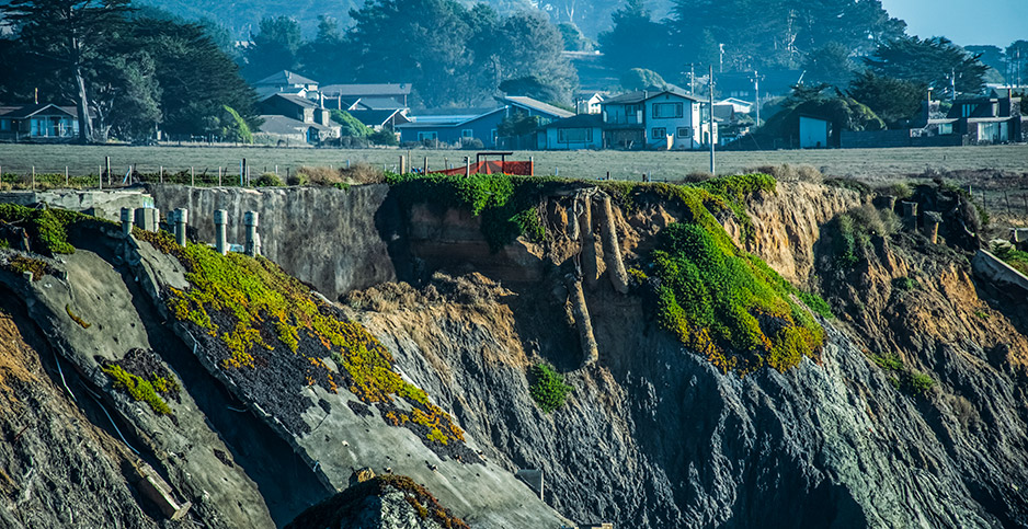 Eroding cliffs near Carmet, Calif., sent a house plunging to the beach. Photo credit: Doug Ogden/Newscom