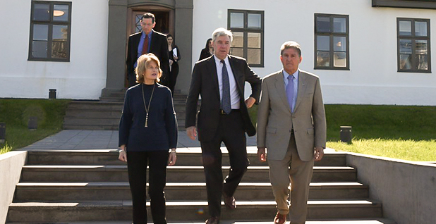 Sens. Lisa Murkowski (R-Alaska), Sheldon Whitehouse (D-R.I.) and Joe Manchin (D-W.Va.) during a stop in Iceland. Sen. John Barrasso (R-Wyo.) can be seen walking behind them. Photo credit: @lisamurkowski/Twitter