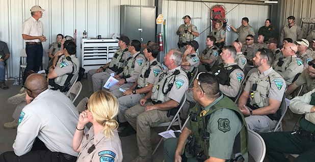 William Woody with BLM and USFS law enforcement agents. Photo credit: Woody/Facebook