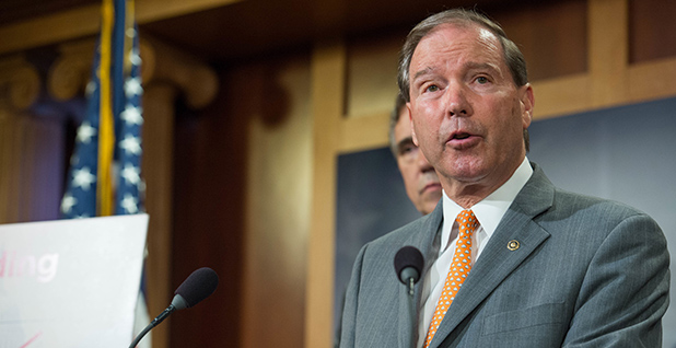Sen. Tom Udall (D-Colo.) speaks at a podium. Photo credit: Tom Udall/Flickr