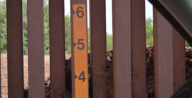 Debris behind fence at U.S.-Mexico border. Photo credit: Ariel Wittenberg/E&E News