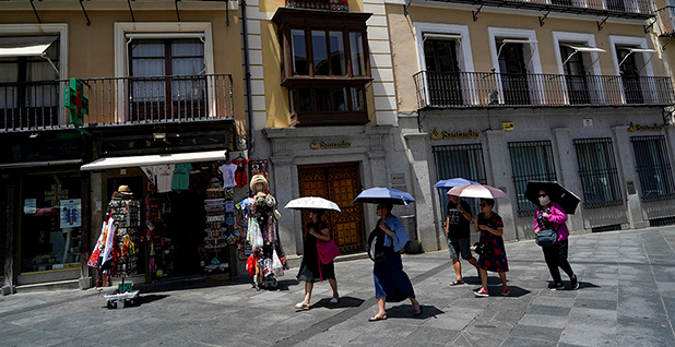 Tourists with umbrellas in Spain. Photo credit: Juan Medina/Reuters/Newscom
