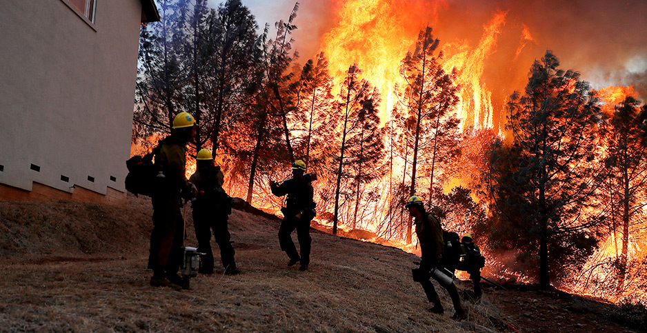 Firefighters at the Camp Fire in Paradise, Calif., in November 2018.   Photo credit: Stephen Lam/REUTERS/Newscom