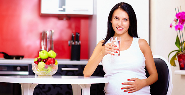 A pregnant woman drinking water. Photo credit: Malgorzata Sulej/Flickr