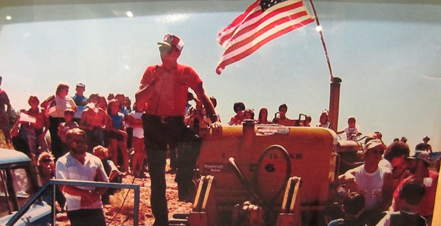 An activist speaks next to an American flag at the Sagebrush Rebellion July 4th, 1980 in Grand County Utah. Photo credit: TheRealDeJureTour/Wikimedia