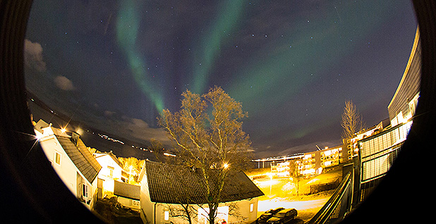 Northern lights are seen over Tromso, Norway. Photo credit: Hinrich Basemann/picture alliance/ Newscom