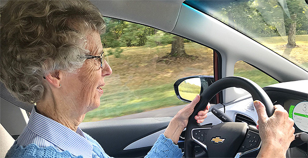 Sister Molly Thompson of Sisters of Charity of Nazareth at the wheel of her Chevy Bolt. Photo credit: Joel Kirkland/E&E News