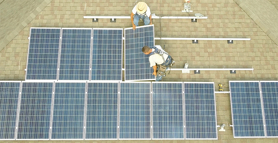 Rooftop solar installations. Photo credit: PosiGen Inc.