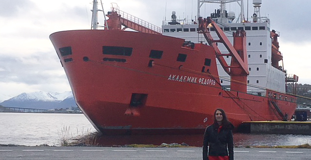 Reporter Chelsea Harvey in front of the Russian icebreaker Fedorov. Photo credit: Shannon Hall
