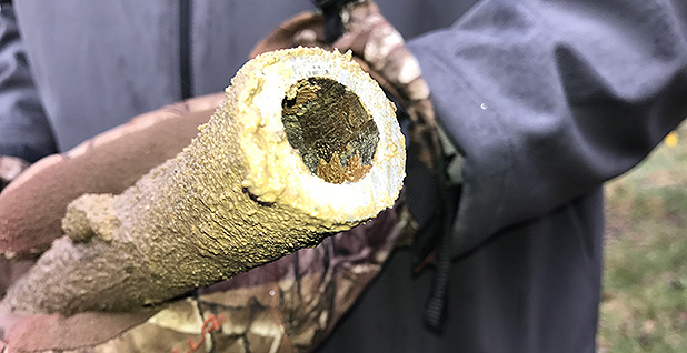 Corroded lead pipe being replaced in Flint, Mich. Photo credit: Ariel Wittenberg/E&E News