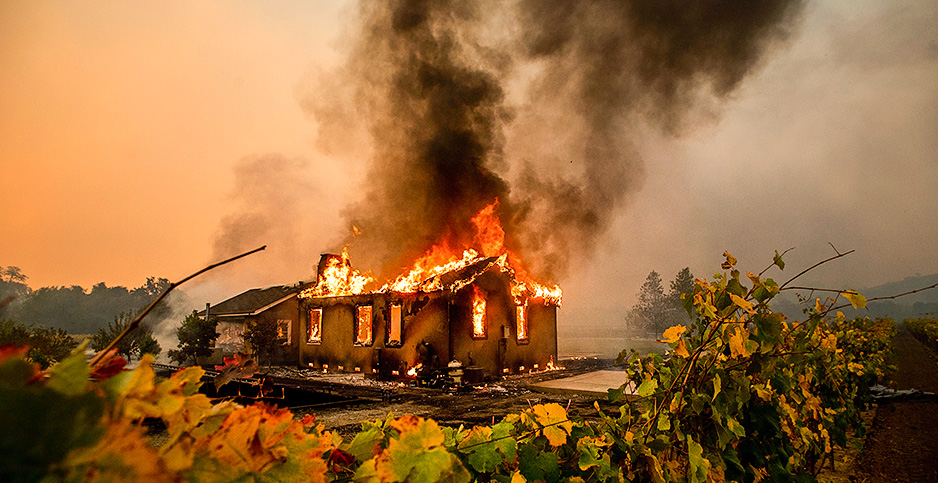 Kincade Fire burns through the Jimtown community of unincorporated Sonoma County, Calif., yesterday. Photo credit: Noah Berger/Associated Press