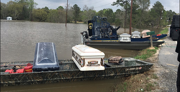"""Officials gathered floating coffins onto boats during a """"cemetery operation"""" in Calcasieu Parish in August 2016. Photo credit: Calcasieu Parish Coroner's Office"""