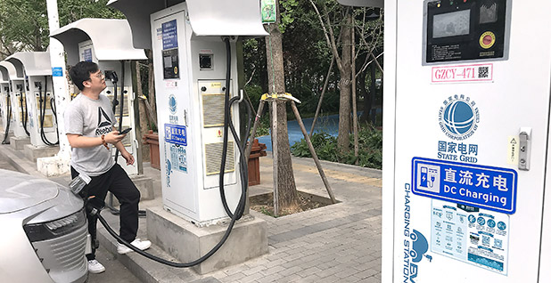 A motorist charging his electric car in Beijing. Photo credit: Stephen Shaver/UPI/Newscom