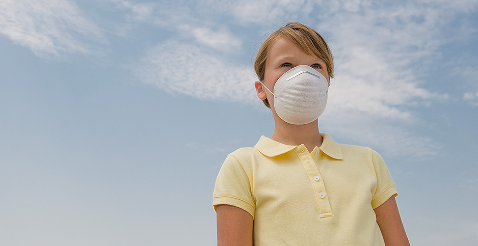 Girl wearing dust mask. Photo credit: Tetra Images Tetra Images/Newscom