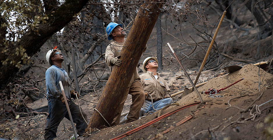 PG&E crews replace power poles. Photo credit: Randall Benton/TNS/Newscom