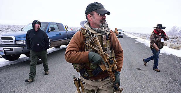 An armed occupier stands guard at the Malheur National Wildlife Refuge. Photo credit: Alex Milan Tracy/Sipa USA/Newscom