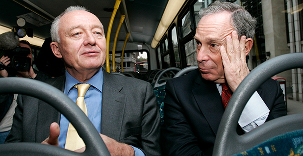 Bloomberg rides on a hybrid bus in 2007 with London Mayor Ken Livingstone. Photo credit: Sang Tan/UPPA/Photoshot/Newscom