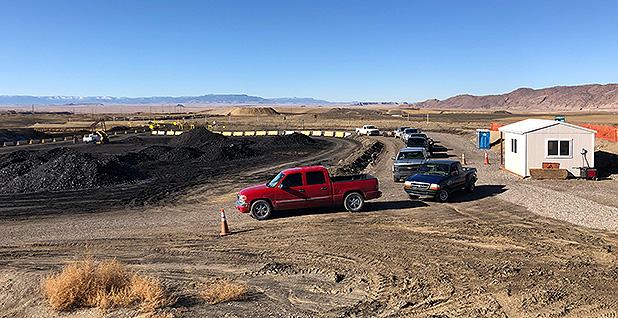 Pickup trucks wait to be loaded with coal at Navajo Transitional Energy Company's Navajo Mine south of Farmington, N.M. Photo credit: Benjamin Storrow/E&E News