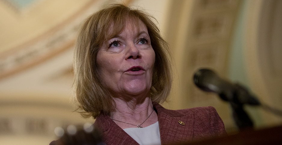 Minnesota Sen. Tina Smith addresses reporters at a Capitol Hill news conference. Photo credit: Stefani  Reynolds/CNP/Polaris/Newscom