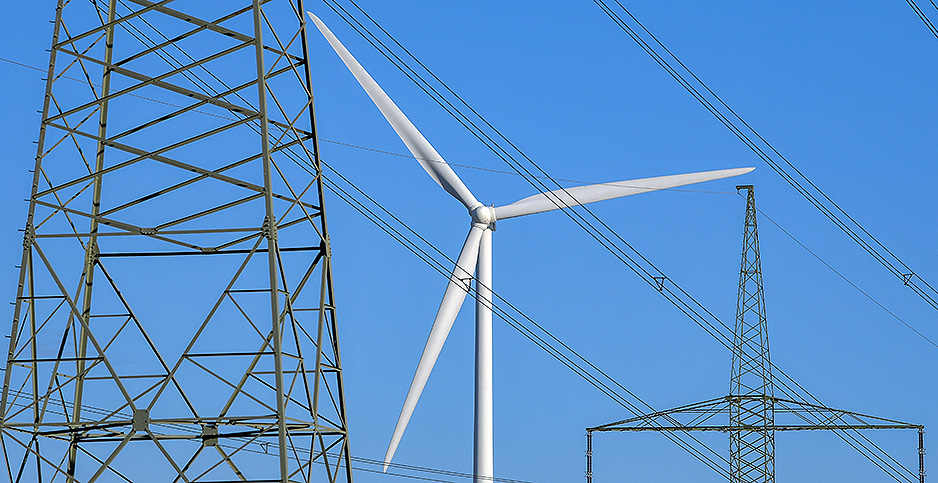 Wind turbine with power lines. Photo credit: Patrick Pleul/dpa/picture-alliance/Newscom