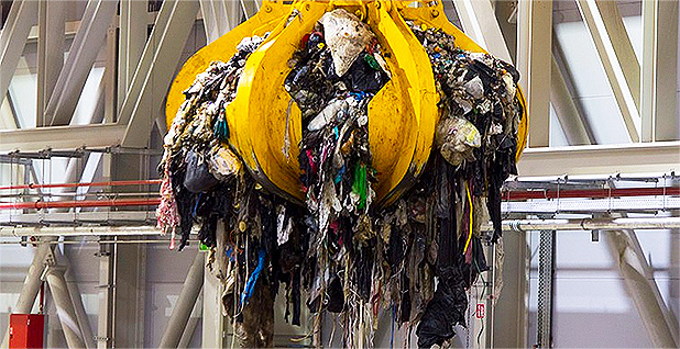 Landfill trash on crane. Photo credit: Covanta Holding Corp.