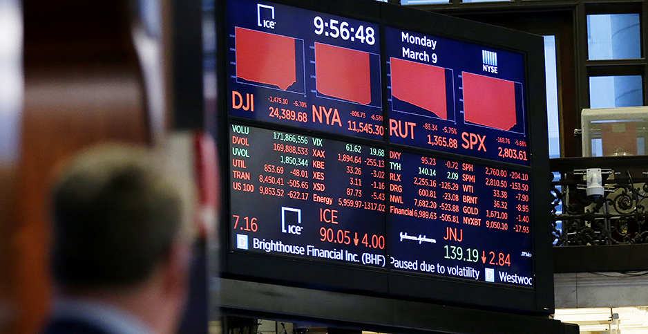A trader on the floor of the New York Stock Exchange. Photo credit: John Angelillo/UPI/Newscom