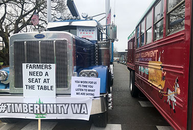 Members of Timber Unity, a group associated with the timber industry, showed up in big trucks outside the Washington State Capitol Building to protest a clean fuel bill.Photo credit: Courtesy of Climate Solutions