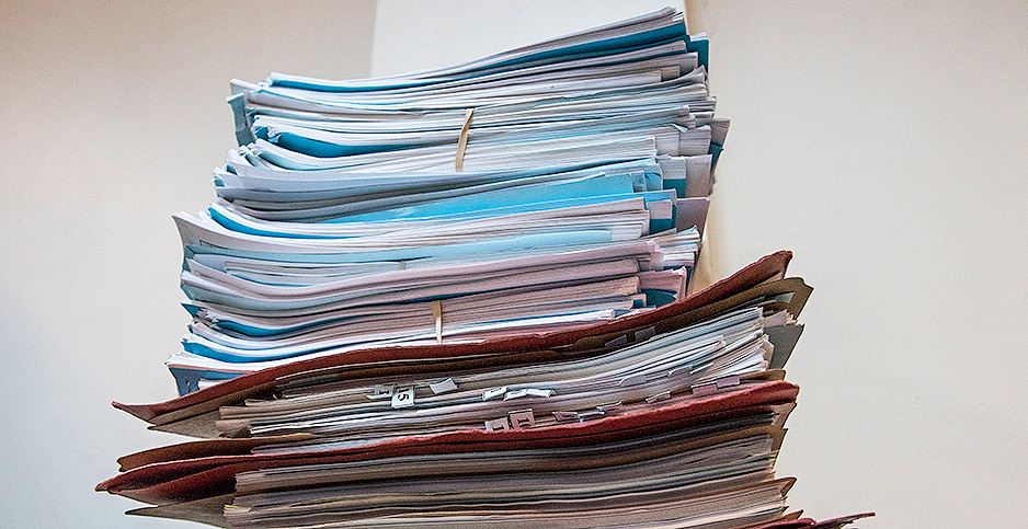 Stack of papers and files. Photo credit: Senior Airman Kirby Turbak/Air Force
