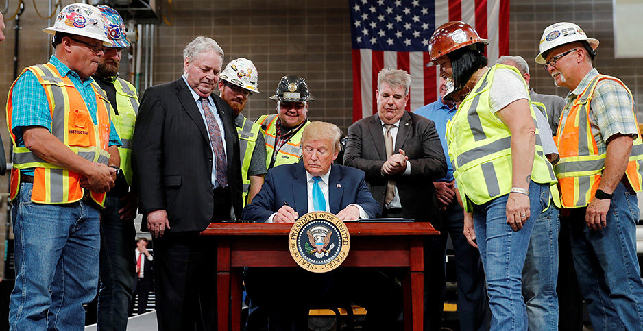President Trump signs executive order in Texas. Photo credit: Carlos Barria/Reuters/Newscom