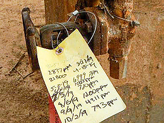 A paper tag attached to a valve at the Navajo plant lists recent volatile organic compound readings. Photo credit: EPA