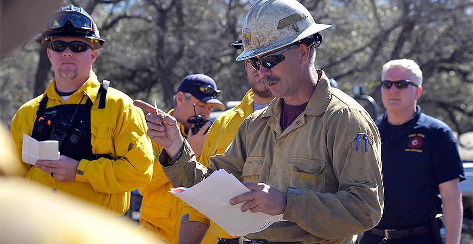 Carl Schwope gives instructions to firefighters. Photo credit: David DeKunder/Defense Department