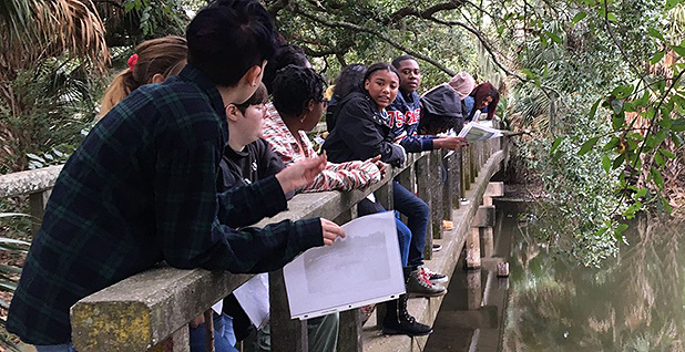 Students on a bridge over water. Photo credit: New Harmony High School