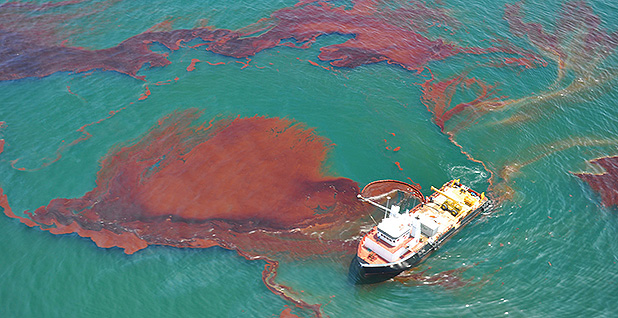 A boat skims oil spilled after the Deepwater Horizon well blowout in the Gulf of Mexico in April 2010. Photo credit: NOAA Office of Response and Restoration/Flickr