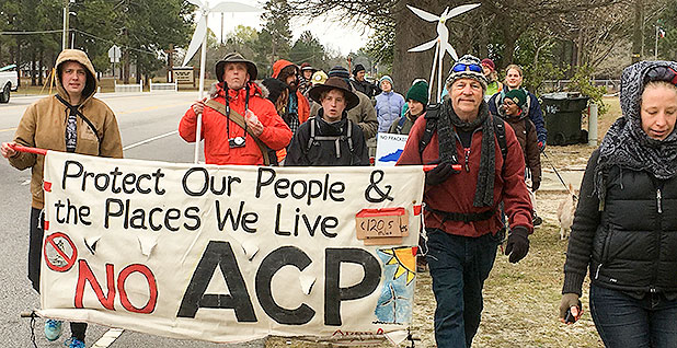 Opponents of the Atlantic Coast pipeline marching in a protest. Photo credit: Mike Soraghan/E&E News