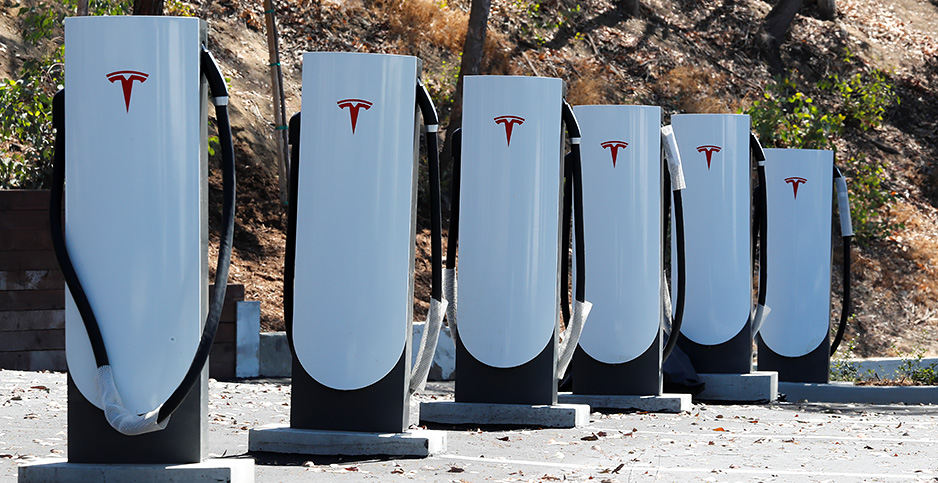 A Tesla charging station in Carlsbad, Calif. The coronavirus pandemic is complicating a state-level push to put more clean cars on the road. Photo credit: Mike Blake/REUTERS/Newscom