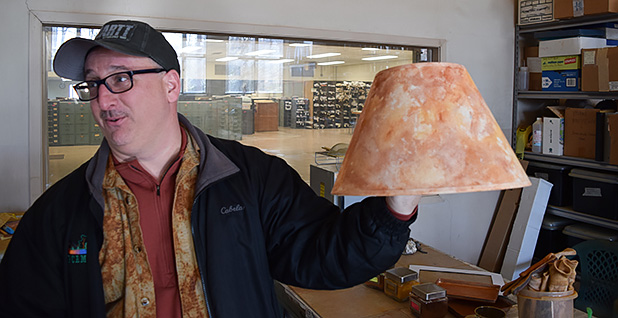 Bobby Hughes shows off a dyed lampshade. Photo credit: Dylan Brown/File/E&E News
