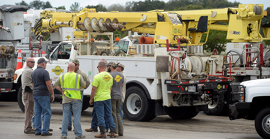 Utility workers gather in a mall parking lot before the arrival of Hurricane Matthew in Florida in 2016. Photo credit: Phelan Ebenhack/REUTERS/Newscom