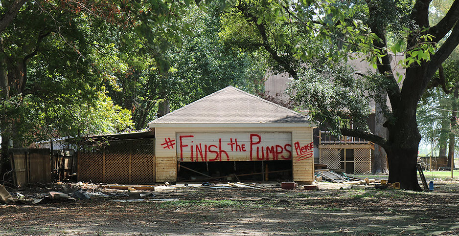 """Graffiti promoting a campaign to """"#Finish the Pumps."""" Photo credit: @usaricenews/Twitter"""