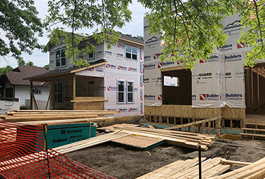 Two homes rise on a North Minneapolis lot that used to support city-sponsored community garden. Photo credit: Daniel Cusick/E&E News