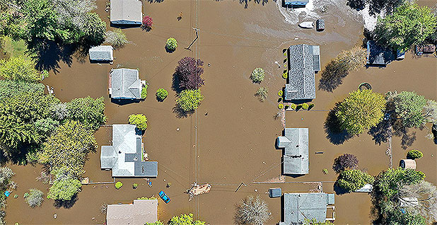 Flooded homes from above. Photo credit: David Guralnick/TNS/Newscom