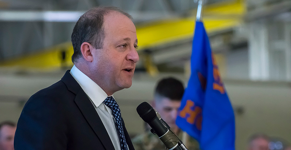 Colorado Gov. Jared Polis signed seven climate bills into law last year. Some environmentalists say he has been slow to implement them. Photo credit: Colorado National Guard/Flickr