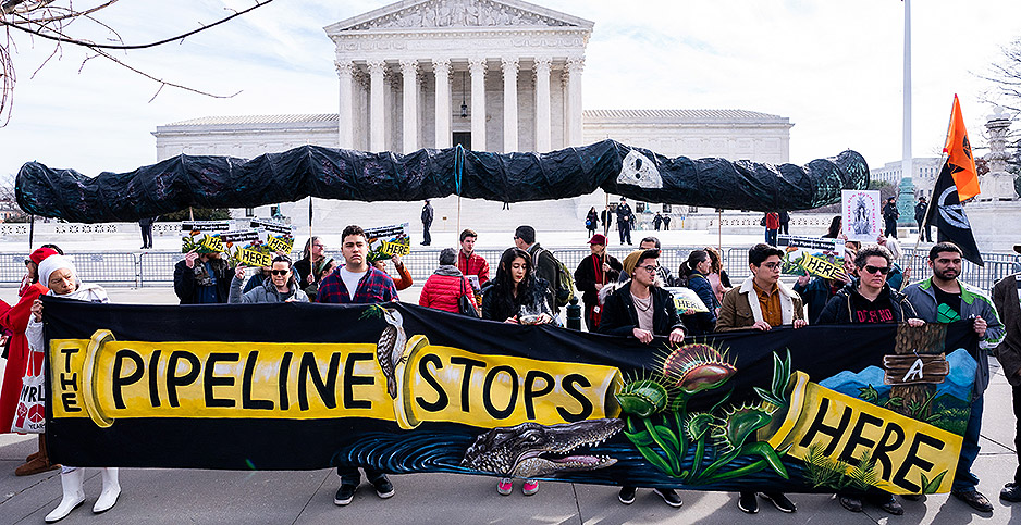 Opponents of the Atlantic Coast pipeline protesting outside the U.S. Supreme Court in February.  Photo credit: Kevin Dietsch/UPI/Newscom
