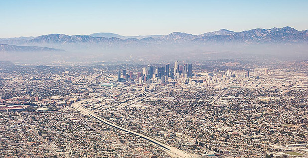 Aerial view of Los Angeles and smog. Photo credit: Wallpaperflare.com