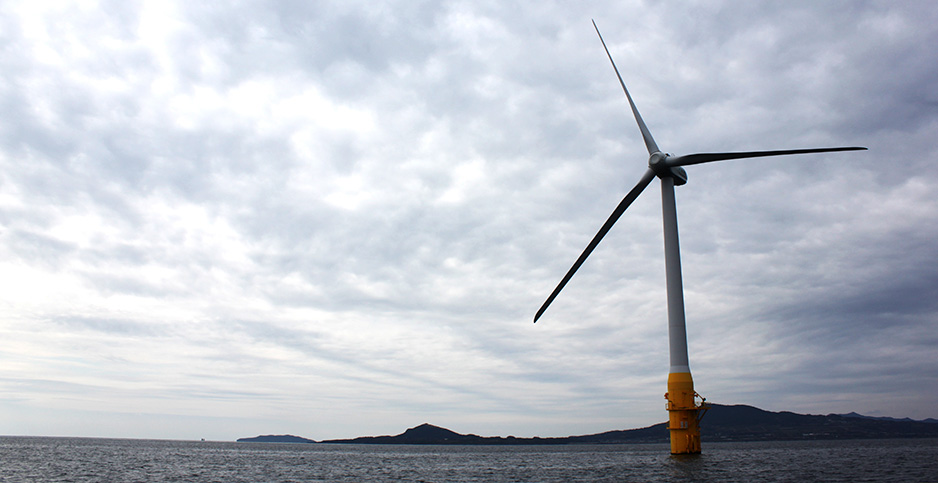 A floating wind turbine churns near the Goto Islands, Japan. Photo credit: mmatsuura/Flickr