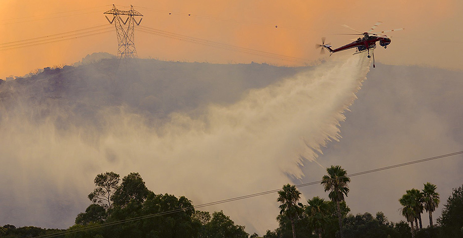 Helicopters fight Valley Fire in Calif. Photo credit: Nelvin C. Cepeda/TNS/Newscom