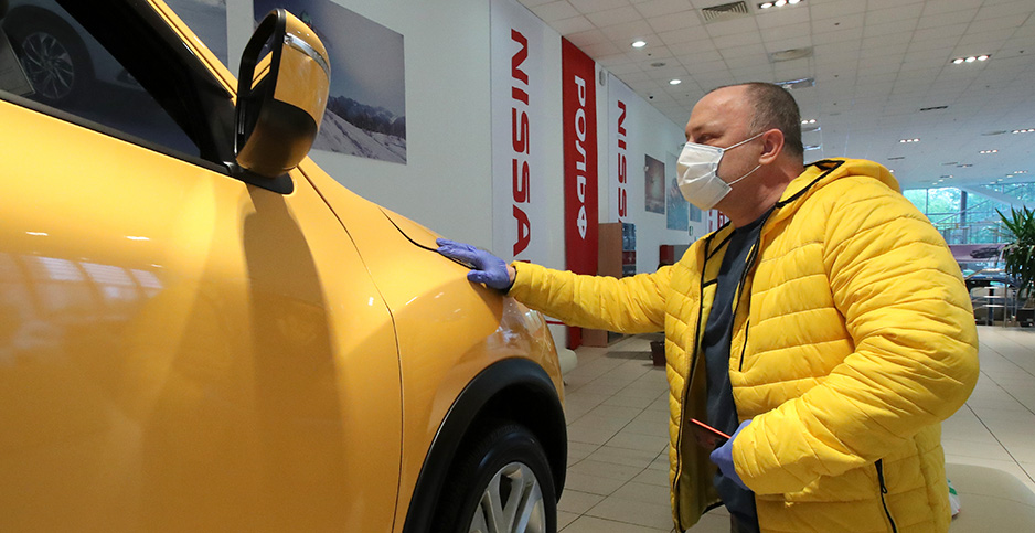 A prospective car buyer checks out a new Nissan model. Photo credit: Sergei Karpukhin/TASS/Sipa USA/Newscom